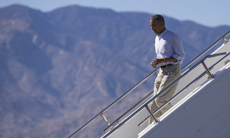 President Obama steps off Air Force One after arriving at Palm Spring International airport, on Feb. 14, 2015.