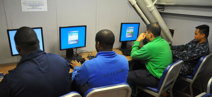 Sailors aboard the USS Carl Vinson use computers in the Learning Media Resource Center to check email from friends and loved ones.