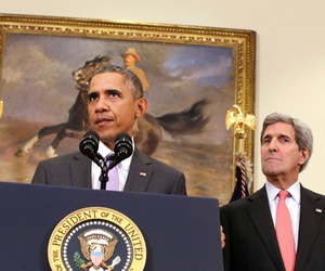 President Barack Obama, flanked by Vice President Joe Biden, left, and Secretary of State John Kerry, right, speaks about the Islamic State group in the Roosevelt Room of the White House in Washington, Feb. 11, 2015.