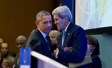 President Barack Obama is introduced by Secretary of State John Kerry before speaking at the Countering Violent Extremism (CVE) Summit, Thursday, Feb. 19, 2015, at the State Department in Washington.