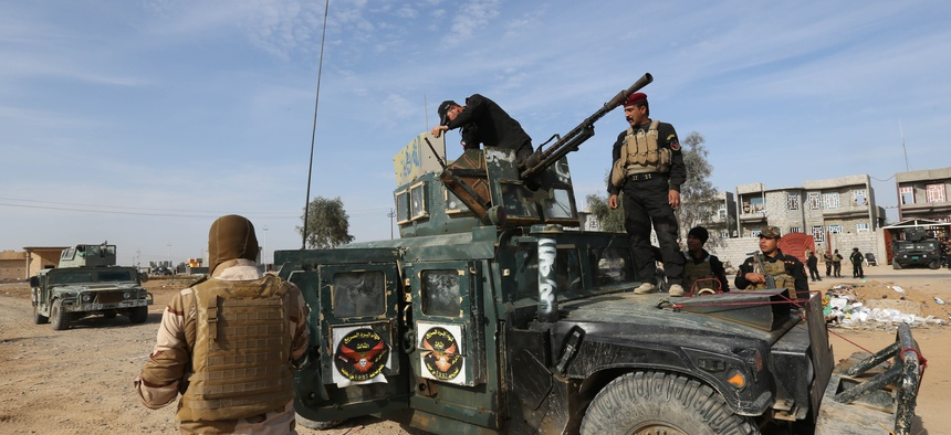 Iraqi security forces deploy to regain control of the villages surrounding the town of Beiji, 155 miles north of Baghdad, Iraq, on Dec. 8, 2014.