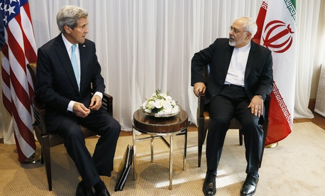 Secretary of State John Kerry meets with Iranian Foreign Minister Javad Zarif before a meeting in Geneva, Switzerland, on Jan. 14, 2015.