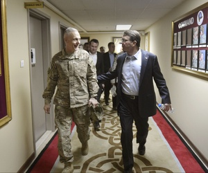 Defense Secretary Ash Carter walks with Lt. Gen. James Terry, the commander of U.S. Army Central after the Regional Security Conference at Camp Arifjan, Kuwait, on Feb. 23, 2015.