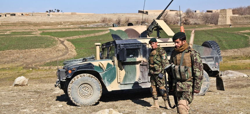 Afghan National Army soldiers provide security during a patrol, on Feb. 14, 2012.