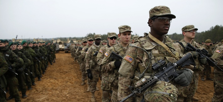 Members of the U.S. Army B Company attend a military exercise at the Gaiziunu Training Range in Pabrade, 38 miles north of Vilnius, Lithuania, on Nov. 13, 2014.