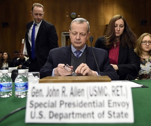 Ret. Gen. John Allen, the top official coordinating the battle against ISIS, prepares to testify on Capitol Hill before the Senate Foreign Relations Committee, on Feb. 25, 2015.