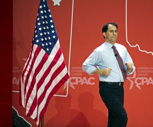 Wisconsin Gov. Scott Walker runs onstage to address the Conservative Political Action Conference, on Feb. 26, 2015.