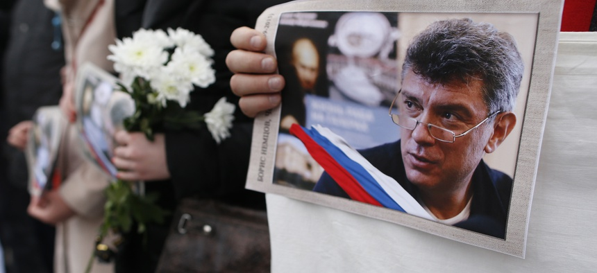 People march in the memory of Russian opposition leader Boris Nemtsov, during a demonstration in Vilnius, Lithuania.