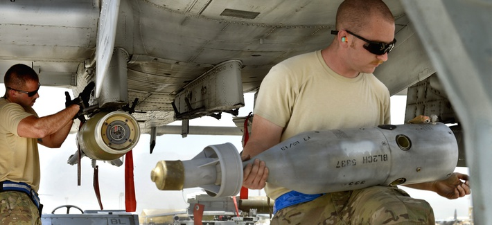 Airmen load a precision-guided munitions on an A-10 Warthog in Afghanistan.