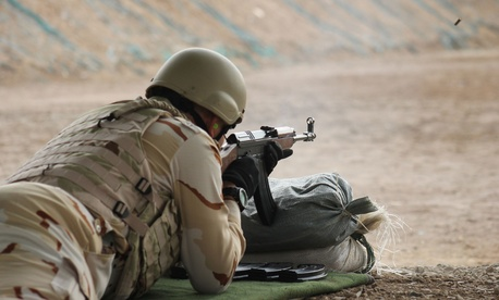 An Iraqi soldier fires a VZ-57 assault rifle during training on Feb. 27, 2015.
