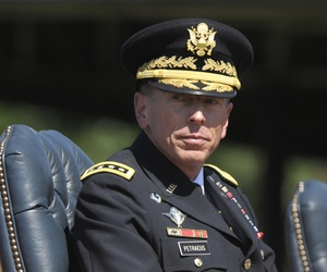 Then ISAF Commander Gen. David Petraeus participates in a retirement ceremony at Joint Base Myer-Henderson Hall in Arlington, VA, on Aug. 31. 2011.