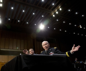 Gen. Martin Dempsey, alongside Defense Secretary Ash Carter, testifies in front of the Senate Armed Services Committee, on March 3, 2015.