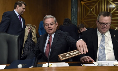 Sen. Robert Menendez, D-N.J., arrives for the committee's hearing on Iran sanctions, Tuesday, Jan. 27, 2015,