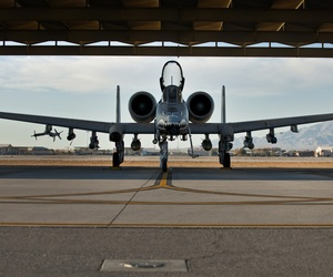 An Air Force NCO with the 23rd Aircraft Maintenance Squadron from Moody Air Force Base, Ga., conducts pre-flight checks on an A-10 Thunderbolt II before a training mission at Green Flag West 11-2 exercise at Nellis Air Force Base, on Dec. 6, 2010.