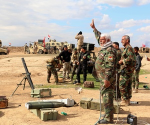 Iraqi army soldiers and volunteers prepare to launch mortar shells and rockets against Islamic State militant positions outside Tikrit, 80 miles north of Baghdad, Iraq.