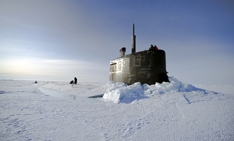 Sailors and members of the Applied Physics Laboratory Ice Station clear ice from the hatch of the USS Conecticutt, on March 19, 2011.