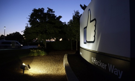 "The Facebook ""like"" symbol is illuminated on a sign outside the company's headquarters in Menlo Park, Calif., Friday, June 7, 2013."