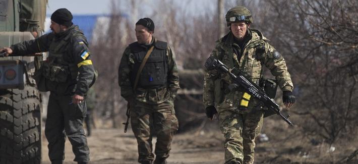 Ukrainian servicemen walk at a front line position east of the Sea of Azov port city, Mariupol, Ukraine, on March 10, 2015.