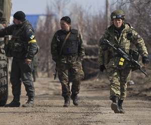 Ukrainian servicemen walk at a front line position east of the Sea of Azov port city, Mariupol, Ukraine, on March 10, 2015.