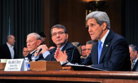 U.S. Secretary of State John Kerry delivers testimony alongside Defense Secretary Ash Carter and Joint Chiefs of Staff Chairman Army General Martin Dempsey before the Senate Foreign Relations Committee on March 11, 2015.