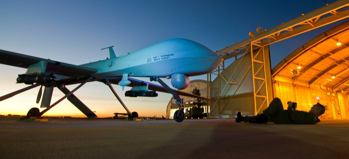 A Predator drone with the 163rd Reconnaissance Wing is shown during post-flight inspection at dusk from Southern California Logistics Airport, formerly George Air Force Base, in Victorville, Calif., Jan. 7, 2012.