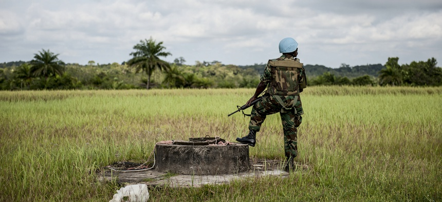 A Ghanaian peacekeeper with the UN Mission in Liberia is pictured on guard duty in Cestos City, Liberia.