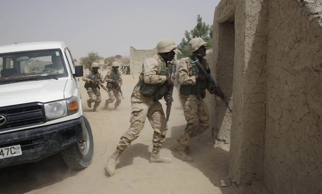 Chadian troops participate along with Nigerian special forces in an hostage rescue exercise at the end of the Flintlock exercise in Mao, Chad, Saturday, March 7, 2015.