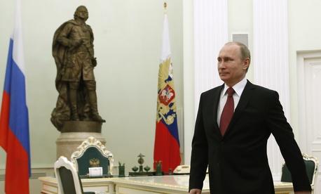 Russian President Vladimir Putin walks to meet visiting Italian Prime Minister Matteo Renzi in Moscow, Russia, Thursday, March 5, 2015.