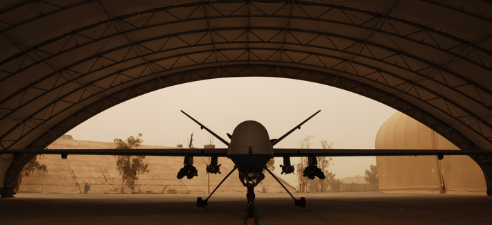 An MQ-9 Reaper in Iraq waits out a sandstorm beneath a shelter in 2008.