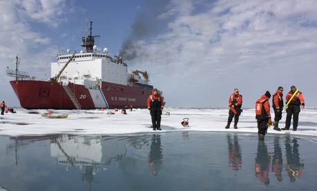 Scientists and Coast Guard swimmers test a melt pond in the Chukchi Sea on July 9, 2010.