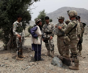 Soldiers assigned to the 501st Infantry Regiment speak with Afghan villagers of upcoming mortar fire in areas surrounding Combat Outpost Narizah, Khost province, on July 7, 2012.