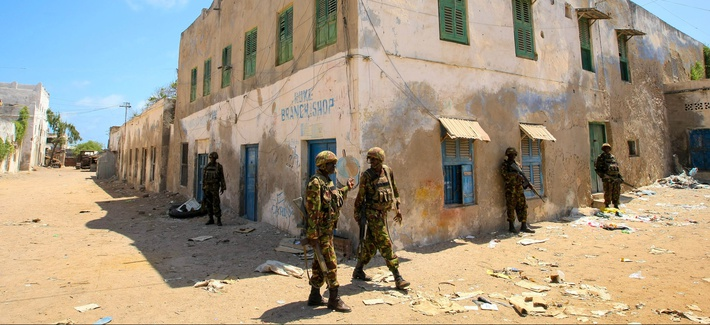 Kenyan soldiers with the African Union Mission in Somalia stand guard on a street in the southern Somalia port city of Kismayo, on Oct. 5, 2012.