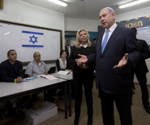 Israeli Prime Minister Benjamin Netanyahu stands with his wife Sara as he speaks to the media, after voting in Israel's parliamentary elections in Jerusalem, Tuesday, Mar. 17, 2015.