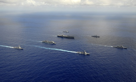 Seen here, ships from the John C. Stennis Carrier Strike Group are underway in the western Pacific Ocean.