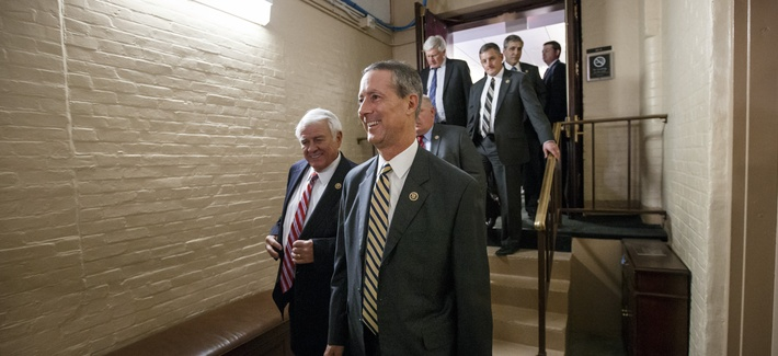 Rep. Mac Thornberry, R-Texas, center, and other House Republicans emerge from a closed-door meeting in the basement of the Capitol, on Feb. 26, 2015.