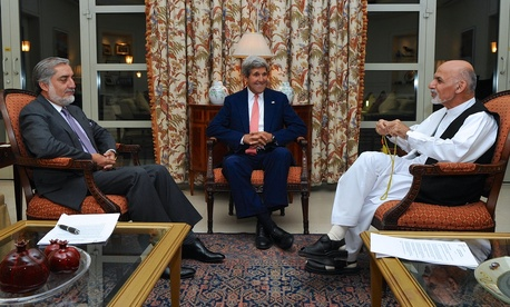 Secretary of State John Kerry sits with Ashraf Ghani and Abdullah Abdullah at the U.S. Embassy in Kabul, Afghanistan, on July 12, 2014.