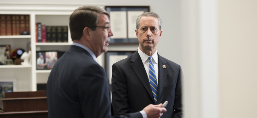 House Armed Services Committee Chairman Mac Thornberry, R-Texas, chats with Defense Secretary Ashton Carter before a before a hearing on March 18.