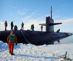 The USS Providence is moored at the North Pole to commemorate the 50th anniversary of the first submarine polar transit.