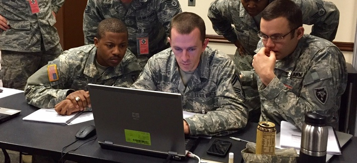 Military personnel across the service take part in the 2015 Cyber Shield Exercise at Camp Atterbury, on March 14, 2015.