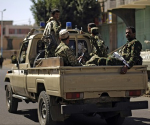 Houthi Shiite Yemenis wearing army uniforms ride in a pickup while patrolling in a street near the Republican Palace, in Sanaa, Yemen, on Feb. 16, 2015.