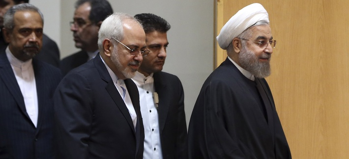 Iranian President Hassan Rouhani and foreign minister Javad Zarif arrive for a conference in Tehran, on Dec. 9, 2014.