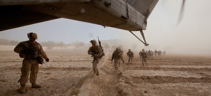 U.S. Marines run toward a CH-53E Super Stallion helicopter assigned to Marine Heavy Helicopter Squadron (HMH) 462 in Gurjat, Helmand province, Afghanistan, Oct. 28, 2013.