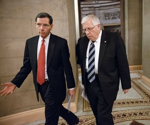 Sen. John Barrasso, R-Wyo., left, and Sen. Mike Enzi, R-Wyo., exit a closed-door meeting in Washington on President Barack Obama's request for Congress to authorize military action against ISIS, Feb. 11, 2015.