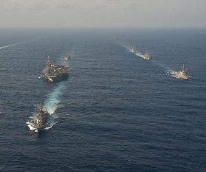 Ships from the USS George Washington Carrier Strike Group, the Japanese Maritime Self-Defense Force and the Republic of Korea Navy sail during a trilateral exercise in the East China Sea, on June 22, 2012.