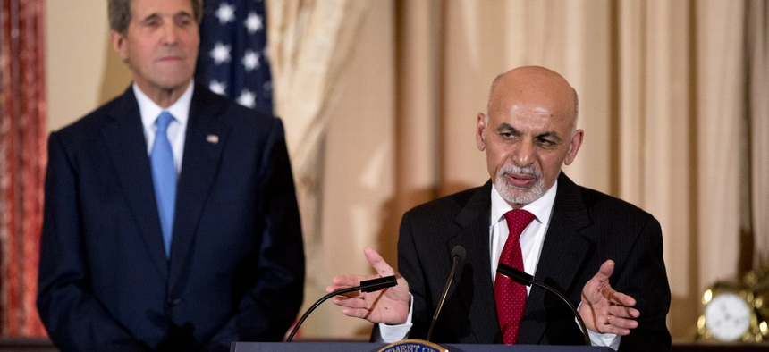 Afghan President Ashraf Ghani speaks while Secretary of State John Kerry listens during a dinner reception at the State Department, on March 24, 2015.