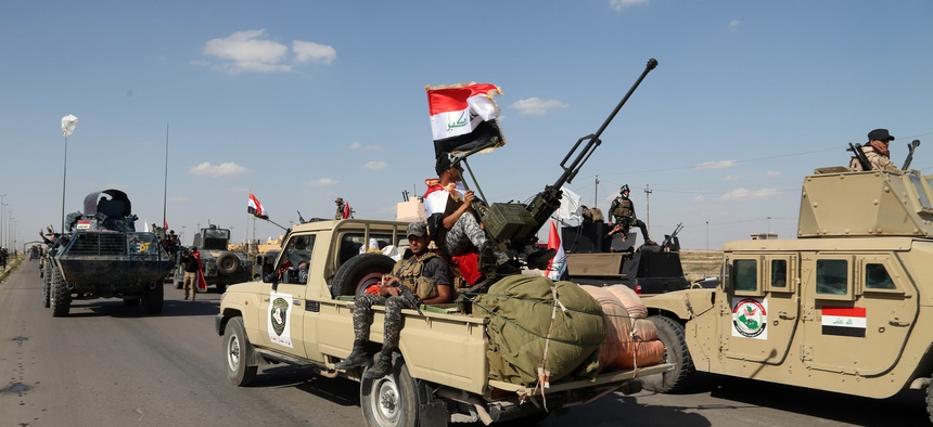 Iraqi security forces prepare to attack Islamic State extremist positions in Tikrit, 130 kilometers (80 miles) north of Baghdad, Iraq, Thursday, March 26, 2015.