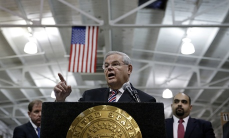 U.S. Sen. Robert Menendez, D-NJ, answers a question as he addresses a gathering Monday, March 23, 2015.