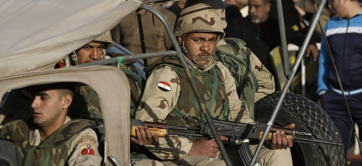Egyptian military police stand guard at the Almaza military airport, on Jan 30, 2015.
