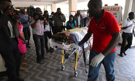 Medics help an injured person at Kenyatta National Hospital, in Nairobi, Kenya, on April 2, 2015.