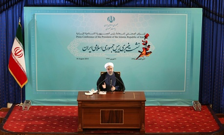 Iranian President Hassan Rouhani speaks during a press conference in Tehran, Iran, Aug. 30, 2014.